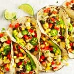 Spicy tofu tacos with lime wedges.