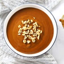 Easy spicy peanut sauce in round dish with whisk.