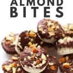 Pile of no-bake chocolate coconut almond bites.