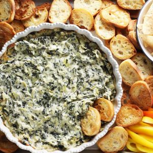 The best spinach artichoke dip, toast, chips and peppers.