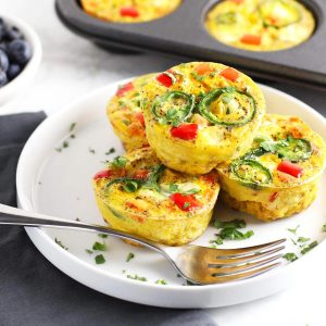 Healthy southwest egg cups on white plate.