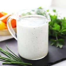 Healthy ranch dressing in glass container.
