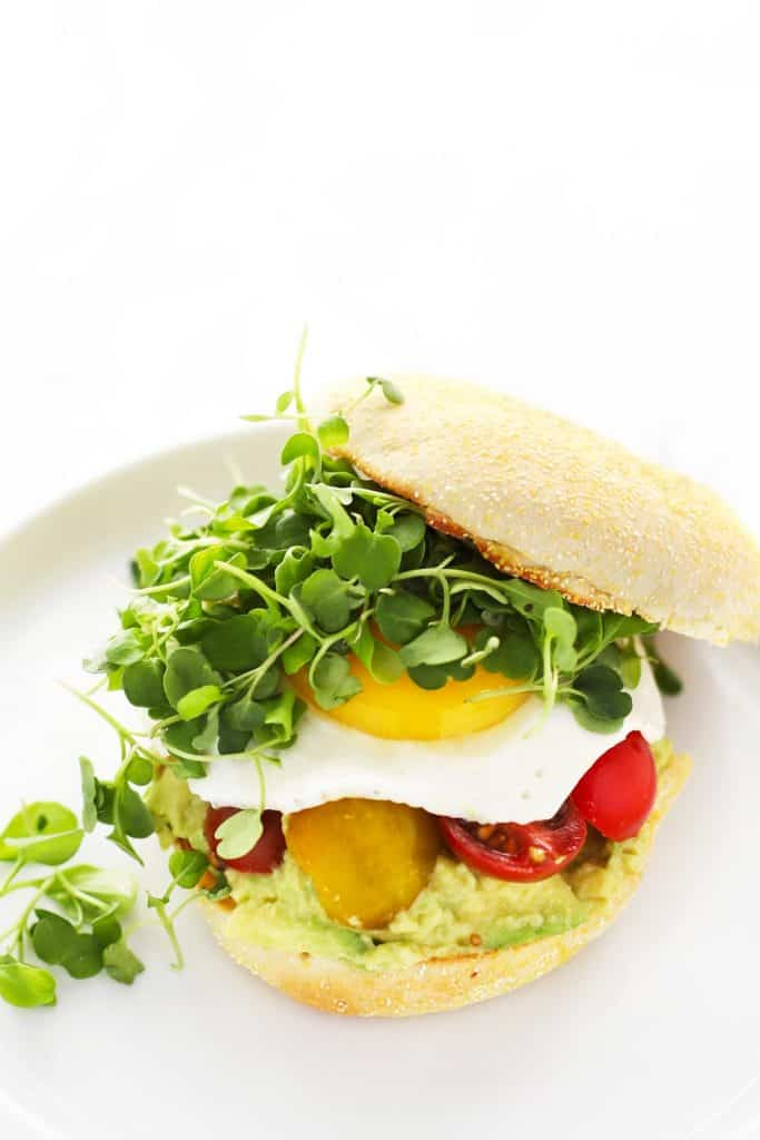 Easy breakfast sandwich on white plate.