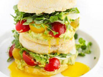 Easy breakfast sandwiches on white plate.