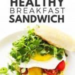 Easy breakfast sandwich on white plate.