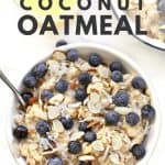 Blueberry coconut oatmeal in white bowl.