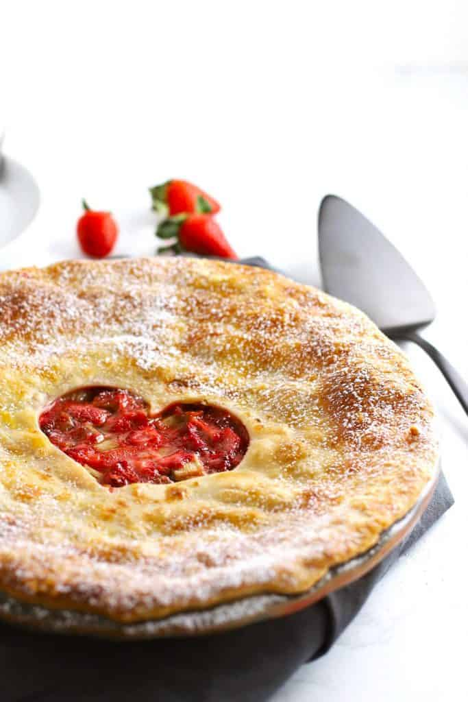 Strawberry rhubarb pie with heart shaped crust.