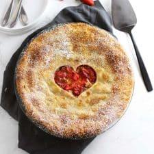 Strawberry rhubarb pie with grey napkin.