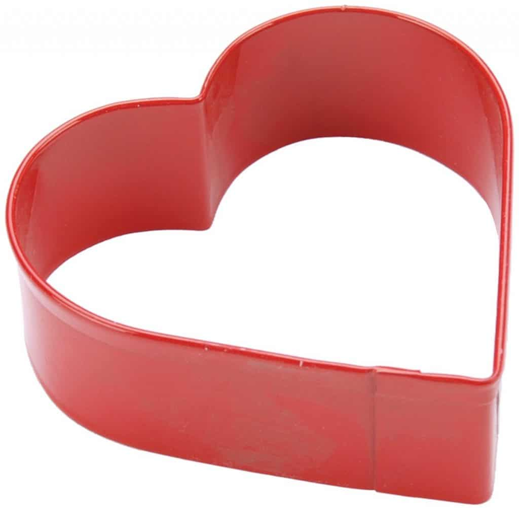 Heart cookie cutter isolated in white.