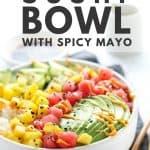 Tuna poke sushi bowl with spicy mayo in white bowl.