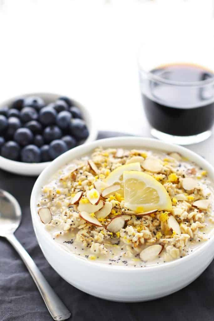 Lemon poppy seed overnight oats in a white bowl with grey napkin.