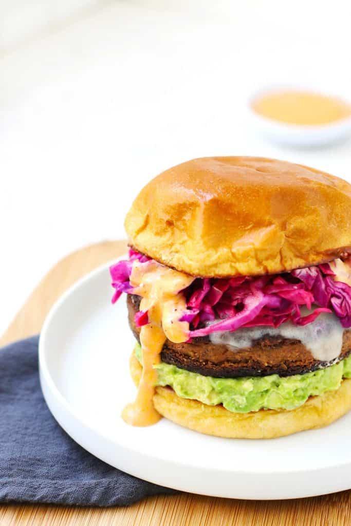 Closeup of black bean veggie burger on white plate.