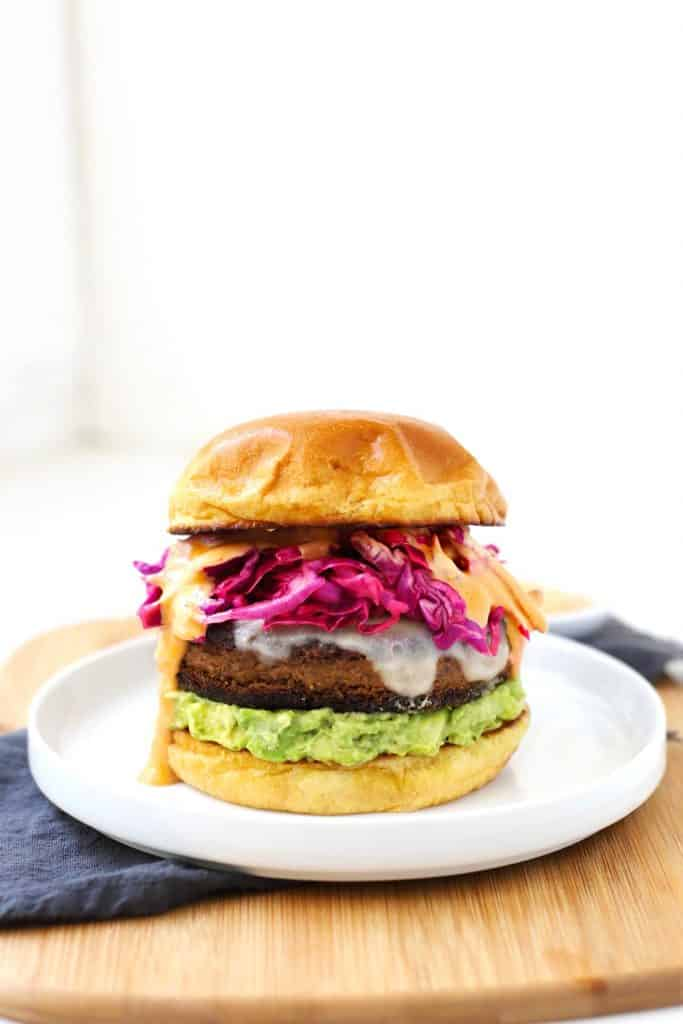 Black bean veggie burger on white plate.