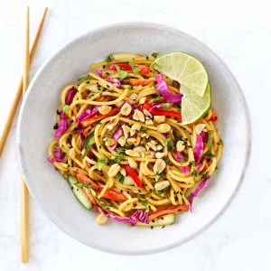 Thai noodle salad in grey bowl with chopsticks.