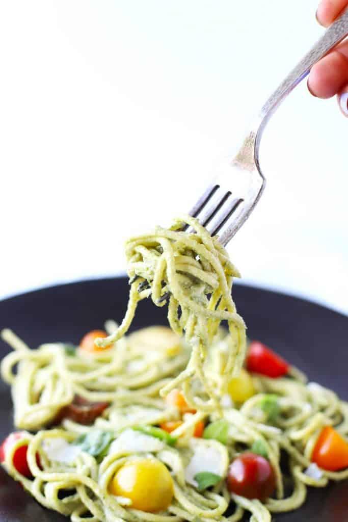 Creamy basil cashew pasta on a fork.