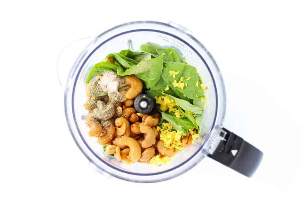 Ingredients for lemon basil cashew sauce in food processor.