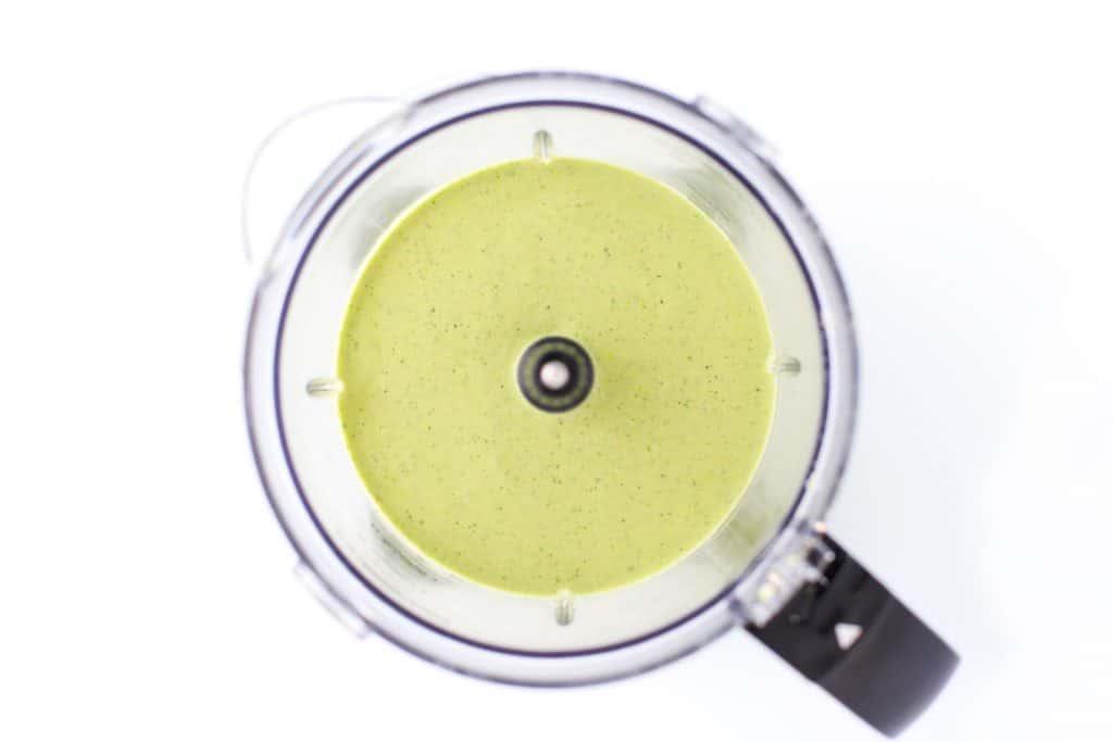 Lemon basil cashew sauce in food processor.
