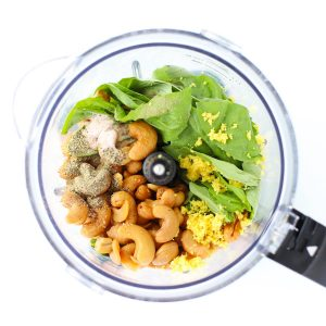 Ingredients for lemon basil cashew sauce in food processor.