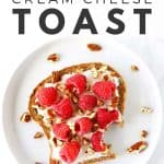 Raspberry cream cheese toast with pecans on white plate.