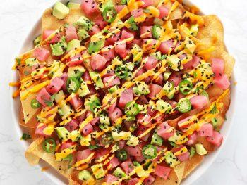 Spicy ahi tuna wonton nachos on white plate.