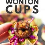Hand holding a wonton cup with avocado, cabbage and shrimp.