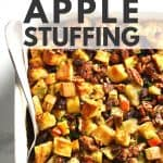 Italian sausage apple stuffing with serving spoon.
