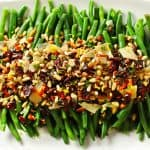 Lemon garlic green beans with crispy pancetta and loaded toppings.