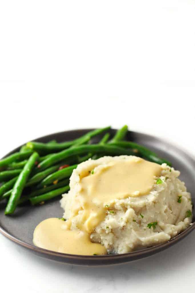 Gravy overflowing mashed potatoes.