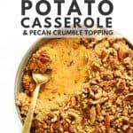 Sweet potato casserole with brass spoon.