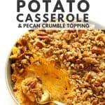 Sweet potato casserole in grey bowl with brass spoon.