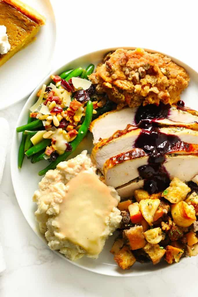 Make-ahead Thanksgiving meal on white plate.