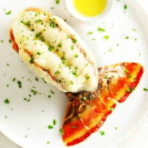Baked lobster tail on white plate.
