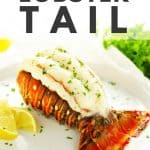 Baked lobster tail with lemon and parsley.