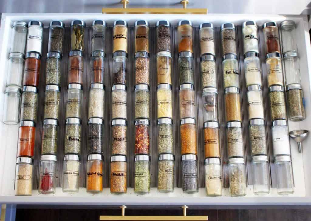 Spice jars in a drawer.