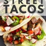 street tacos on grey plate