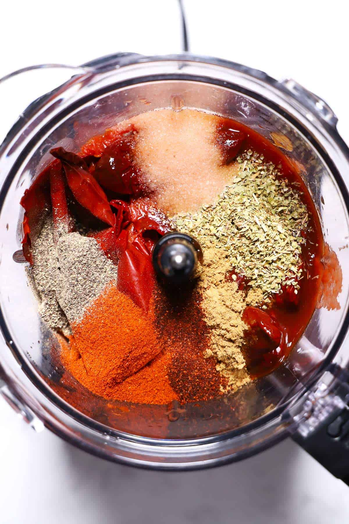 Birria sauce ingredients in a food processor.