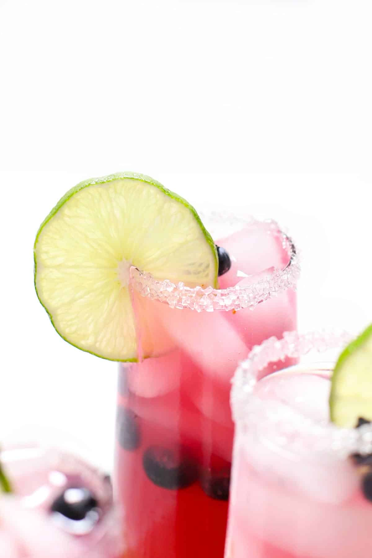 Close-up view of a blueberry margarita over ice.