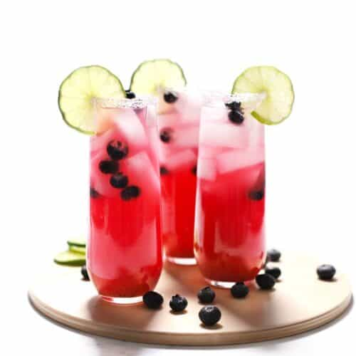 Blueberry lime margaritas on a tray.