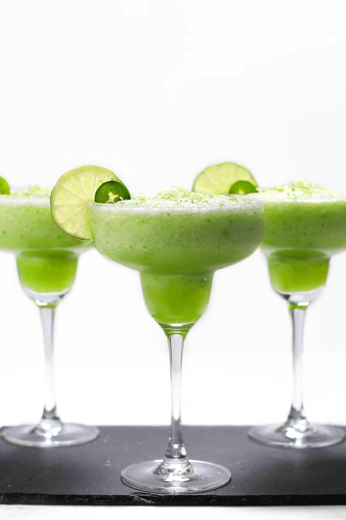 Frozen jalapeno margaritas on a tray.