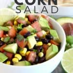 Black beans, corn, tomato and avocado in white bowl.