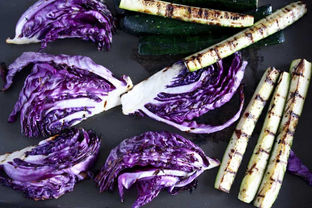 Grilled cabbage and zucchini on pan.