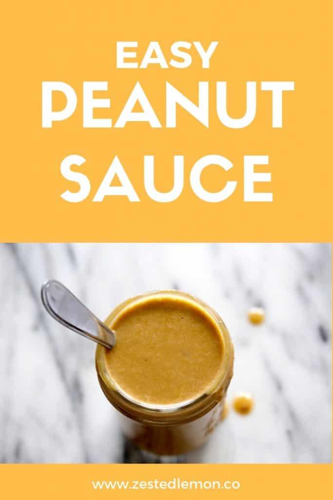 Peanut sauce in mason jar with spoon.