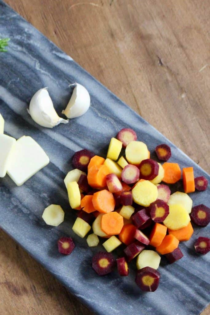 Sliced carrots on blue cutting board.