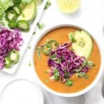 Soup with avocado and cabbage in white bowl.