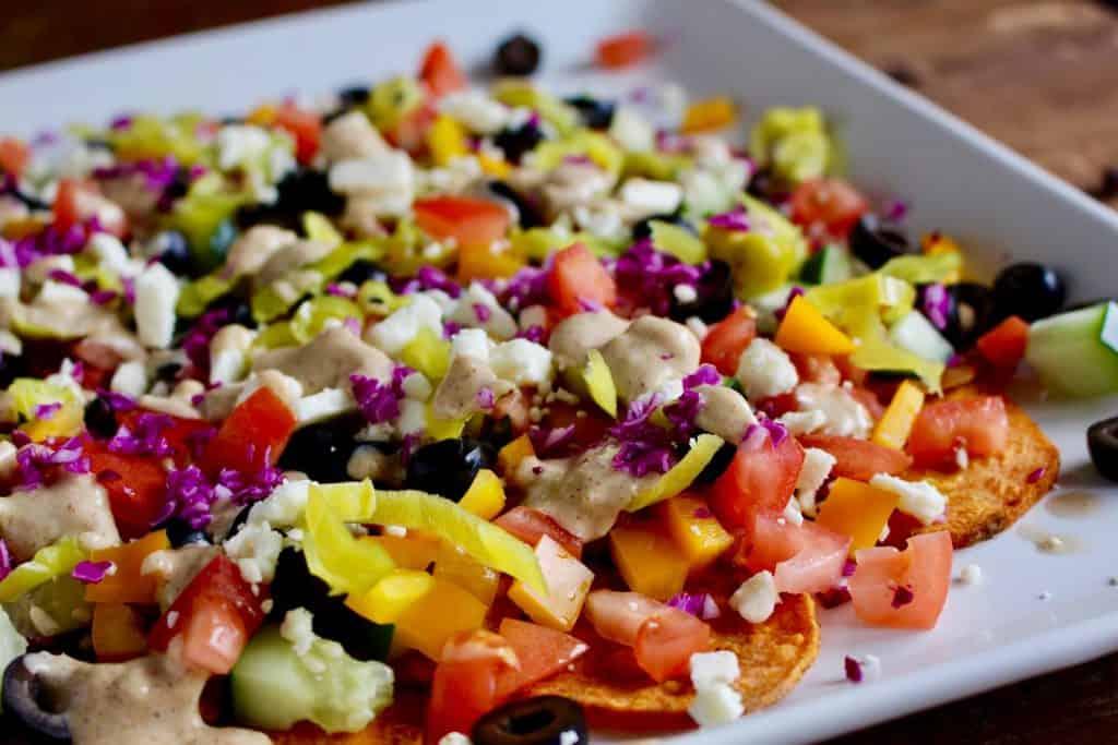 Sweet potato nachos on white platter.