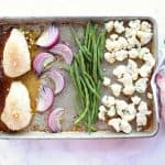 Onions, beans, cauliflower and chicken on sheet pan.