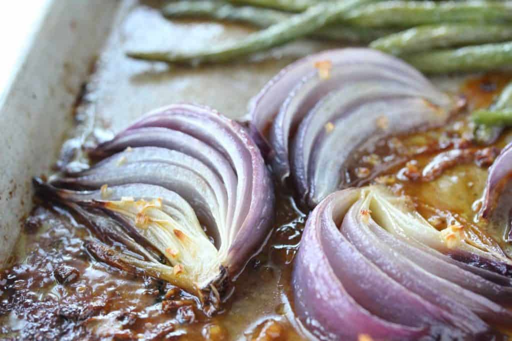Red onions on sheet pan.