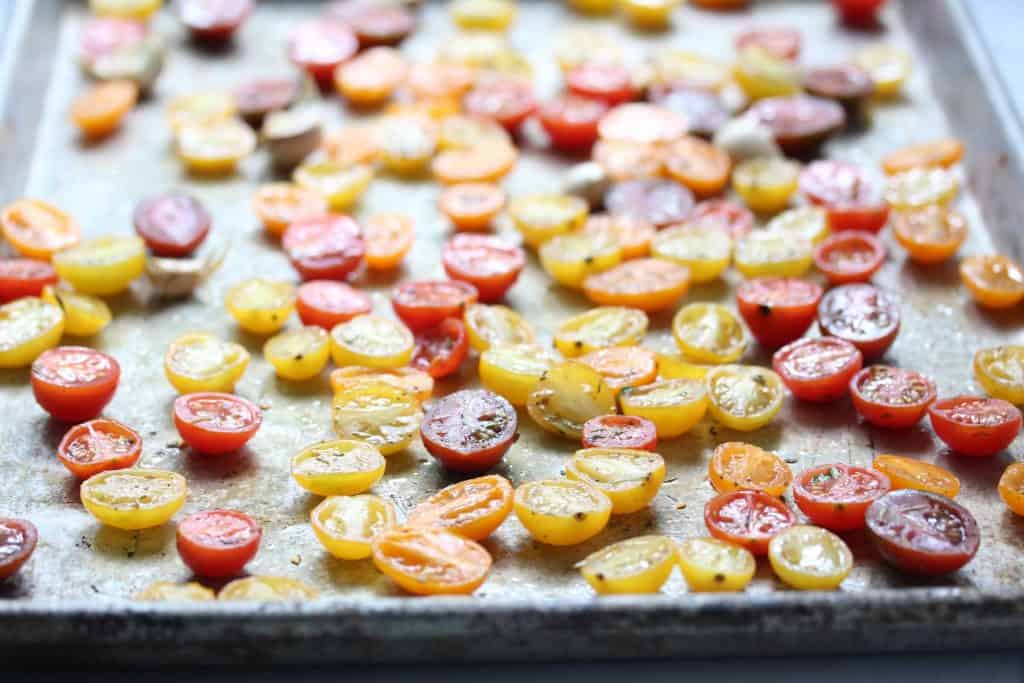 Cherry tomatoes on sheet pan.