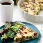 Slice of quiche on green plate.