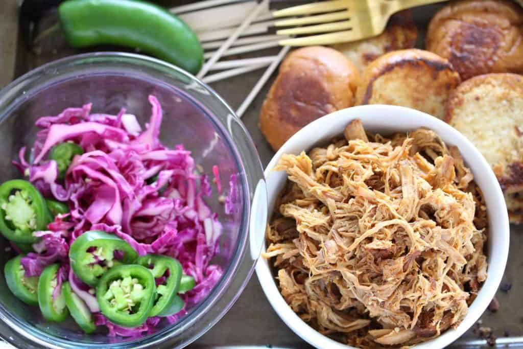 Pulled pork, cabbage and buns on sheet pan.